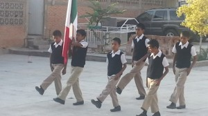Young Mexican patriots from the homes presenting the colors of México.