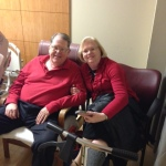 Mike and Becky with her scooter while being released from the hospital.